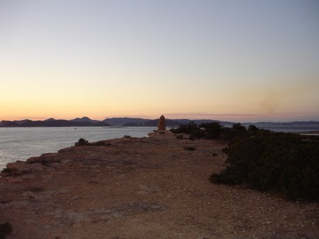 Inside the Ses Salines natural park at dusk, looking towards Ibiza