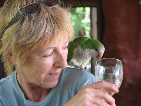 Annie sharing a glass of wine with her misanthropic parrot