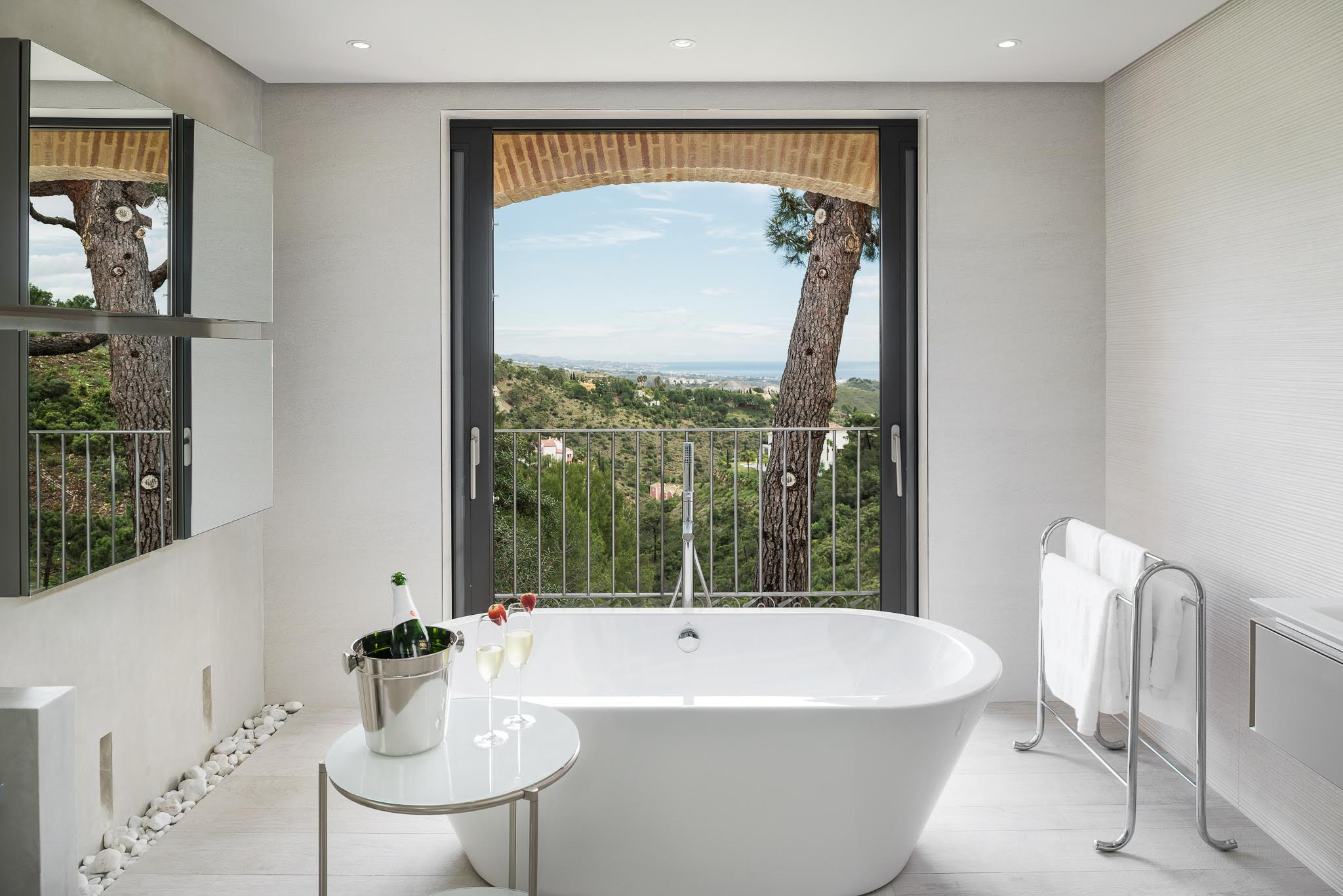 Master bathroom with a view, from a house renovated by clients of mine in El Madroñal, in the hills behind Marbella