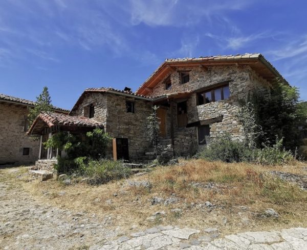 Spanish eco-village abandoned medieval hamlet restoration Spain.